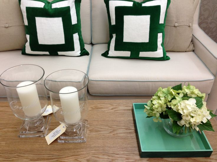 These green cushions add impact to your sofa