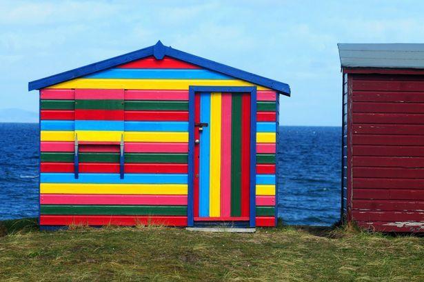 A colourful beach hut on Hopeman beach #Scotland #BeachHuts