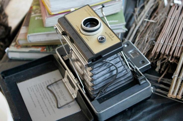 love the accordion style Polaroid cameras :)