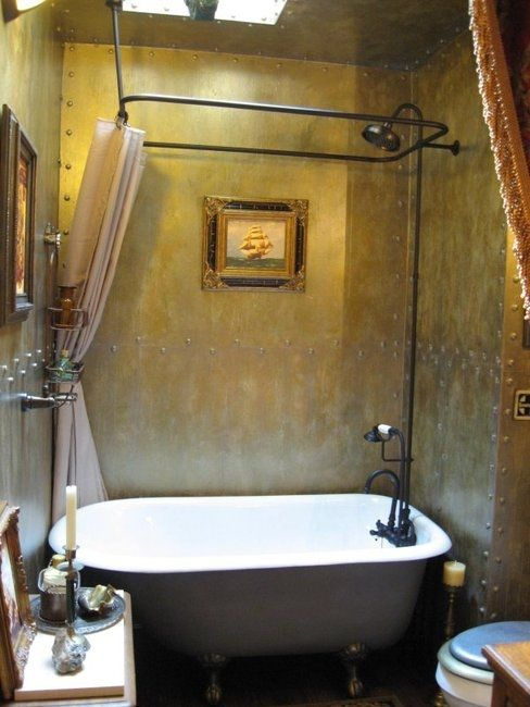 Steampunk Bathroom. I like the metal walls and bolts. They need more copper color and less gold.