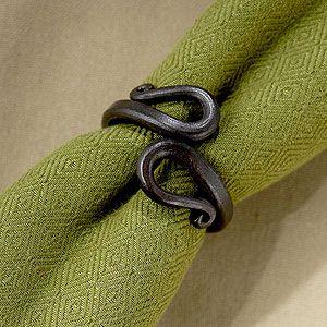 I like the old world blacksmith look of these napkin rings.