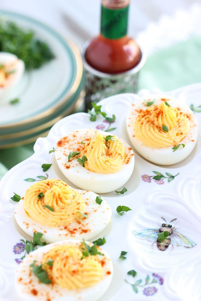 The easiest and BEST Deviled Egg recipe ever with a secret ingredient that will leave your guests begging to know what it is! | @suburbansoapbox