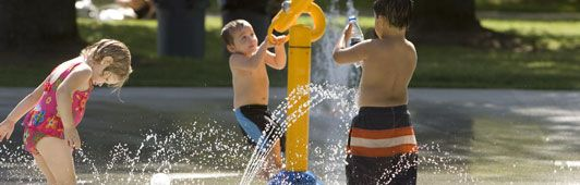 Water Spray-ground at Blue Lake Park - FREE - The colorful, action-packed features spray, gush, dump and pour water from a variety of whimsical devices including oversized nozzles, buckets and even a large frog you can leap through.