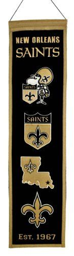"""NFL New Orleans Saints Heritage Banner by Winning Streak. $21.99. This unique wool, vintage style banner is decorated with distinctive embroidery and applique detail, and highlights old vintage logos. Ideal as a gift or for decorating an office, gameroom or bedroom.. Genuine wool blend fabric.. A uniquely hand-crafted, vintage style, wool banner featuring intricate embroidery and applique design detail.. One 32"""" x 8"""" licensed wool banner commemorating past vintage logos."""