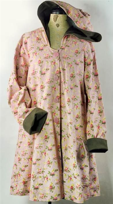 APRIL CORNELL ROSEBUD JACKET:  A photograph cannot convey how wonderful this soft, cotton coat feels to the touch. A vintage print in a bluish pink pairs with a deep loden green lining that contrasts the hood and rolled cuffs.