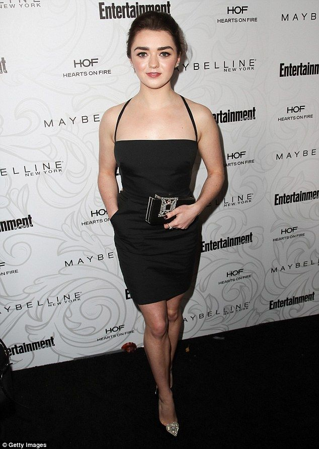 Chic: The 19-year-old star showcased her svelte physique in a figure-hugging black mini dr...