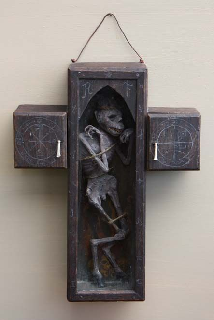 * The Faustian Cross ~ The physical manifestation of a lesser daemon, bound in a wooden cross. Whatever you do, don't break the glass! ~ by Jacob Petersson *