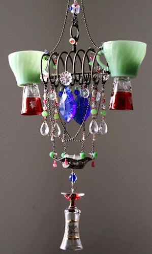 chandelier made from old glassware cups and glasses