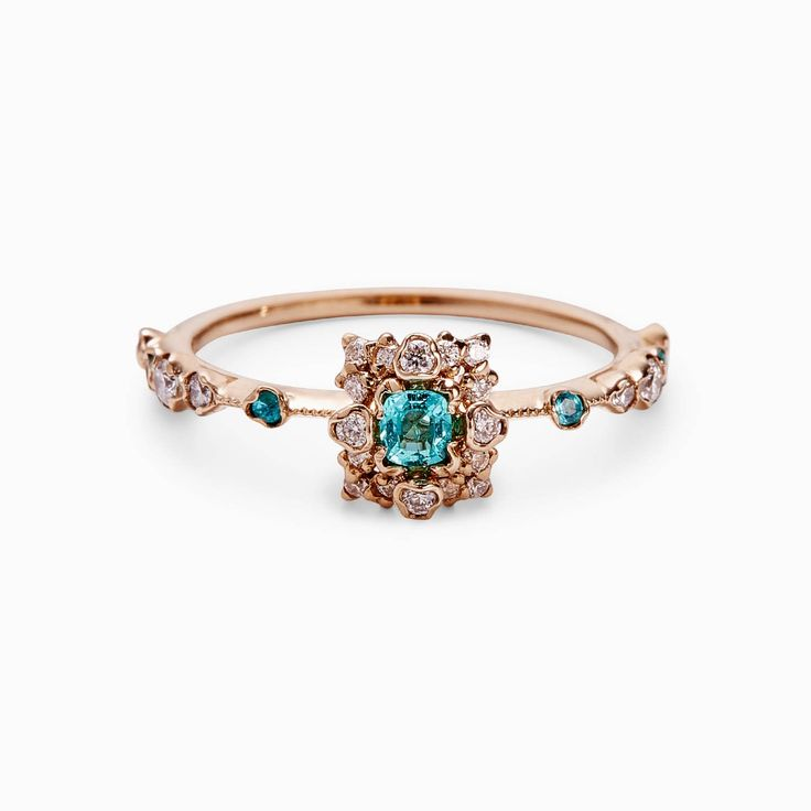 Delicate, elegant, modern. Kataoka brings a male perspective to jewelry-making, offering balance and metal-carving skills that utilize Japanese elements of Wabi Sabi. Paraiba tourmaline with diamonds brings strength and vitality; the rose gold setting underscores a deep connection to love.