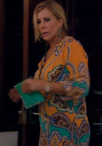 Vicki Gunvalson's Turquoise Studded Chain Strap Bag | http://www.bigblondehair.com/real-housewives/rhoc/vicki-gunvalsons-turquoise-studded-chain-strap-bag/