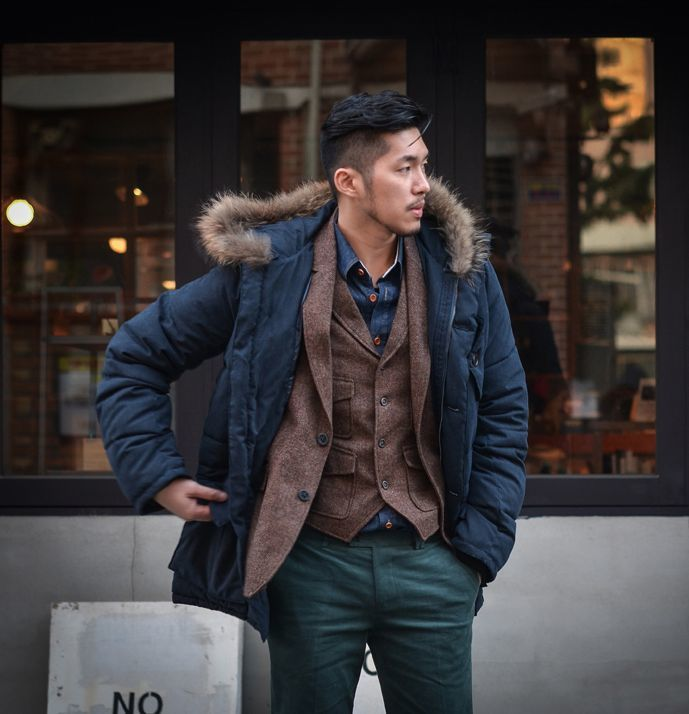 Stand out among other stylish civilians in a navy parka and teal chinos. Shop this look on Lookastic: https://lookastic.com/men/looks/parka-blazer-waistcoat/14883 — Navy Denim Shirt — Dark Brown Wool Waistcoat — Dark Brown Wool Blazer — Navy Parka — Teal Chinos