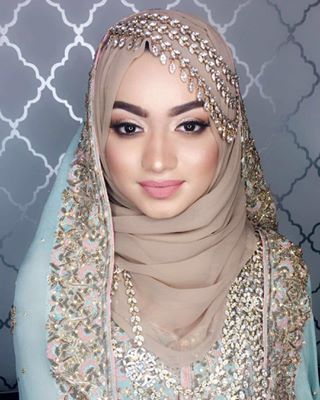 That face is just, wow. | 28 Gorgeous Brides Wearing Hijabs On Their Wedding Days