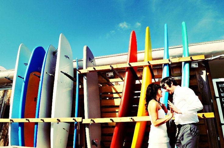 Bride, Groom, and Surfboards! Weddings at Post Card Inn | St Pete Beach, FL | Simple Weddings. www.simpleweddingsflorida.com/postcardinn.html