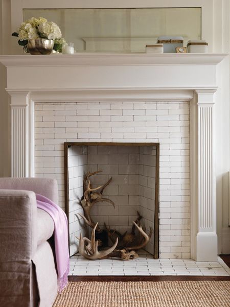 styled by Sarah Hartill and Michael Penney, photographed by Stacey Brandford. The now ubiquitous fallen antlers find a home in the hearth in our Art of Display story.