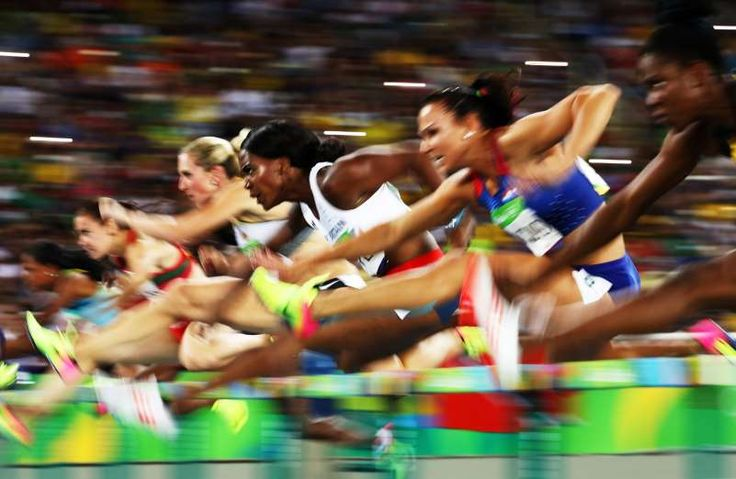 Tiffany Porter of Great Britain (C) competes in the women's 100m hurdles semifinal at Olympic Stadium on Aug. 17.