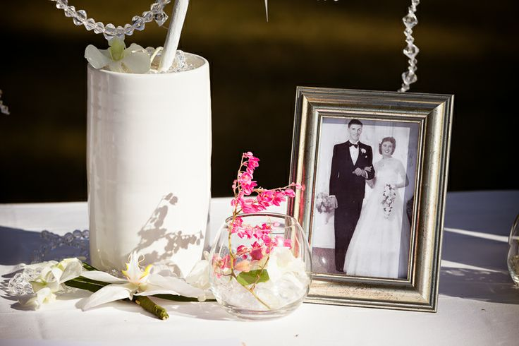 Photographs from our grandparents wedding on the guest book table