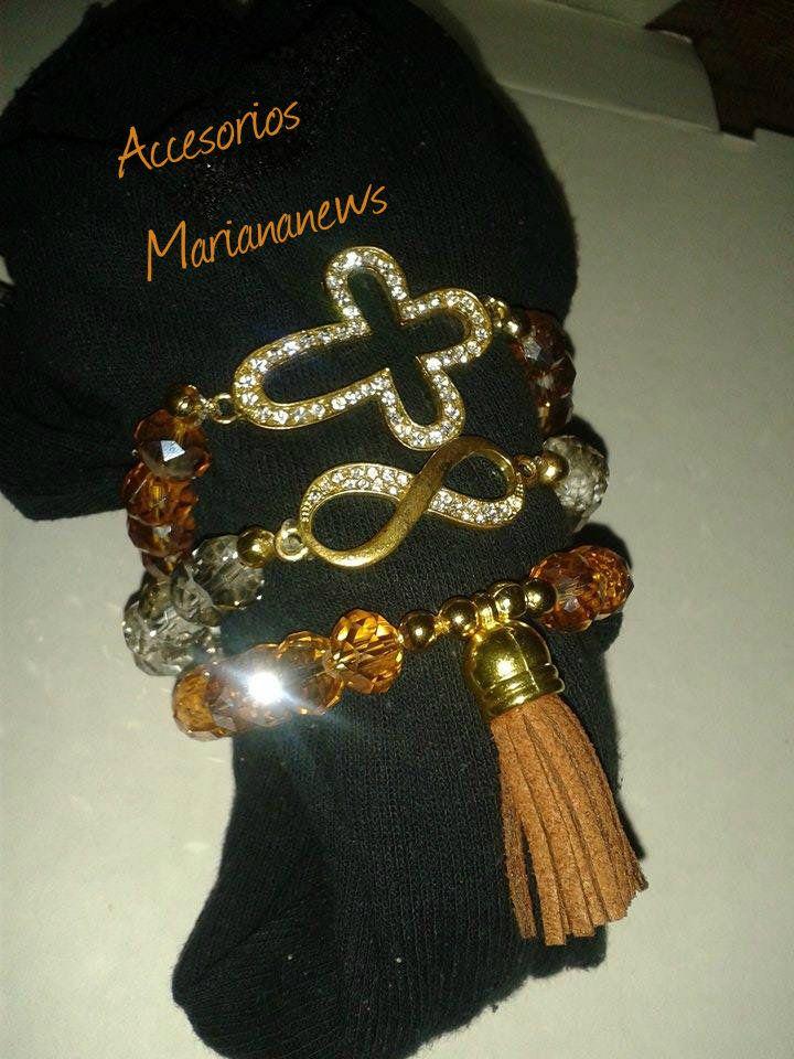 En venta juego de tres pulseras hecho a mano con cristales y dijes (motita, infinito y cruz) (búscame en Facebook Accesorios Mariananews)