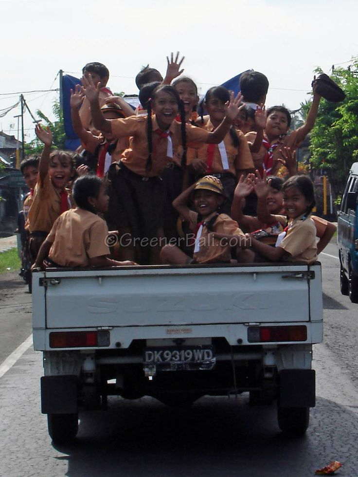 Fun on your way back from school.... Of course, in most developed nations those precious kids would not be allowed to travel with all the risks this mode of transport presents to their safety in the event of an accident. Then again, most developed nations don't have the Bali gods to keep them safe. #schoolkids