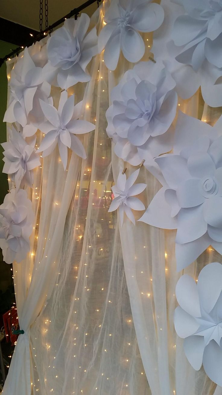 Paper flowers on shear curtain backdrop by karrieforsling