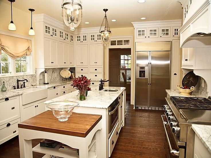 I like the butcher block the island in between for easy for Angela bonfante kitchen designs