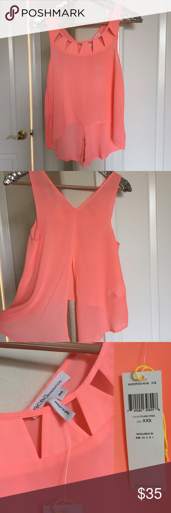 BCBGeneration Cutout Top Brand new with tag! Bright coral color. Size XXS (US 0) but can also fit XS! BCBGeneration Tops Crop Tops