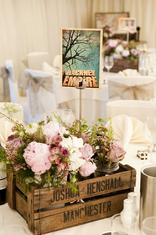 Flowers in wooden crates are the perfect centerpiece and