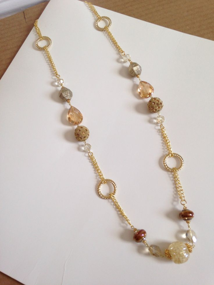 Gold creams and tans long necklace.