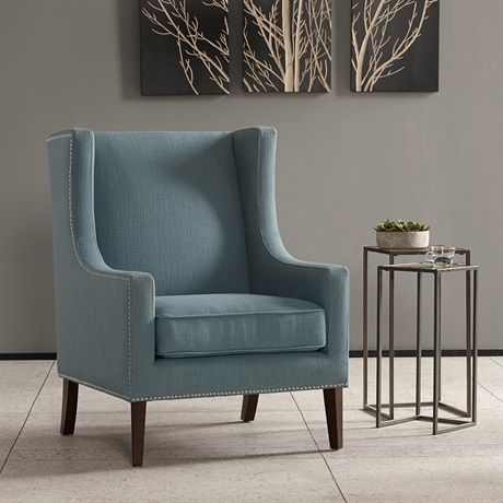 A wing back chair like this is a classic chair. Combining an updated print fabric with contrasting silver nail head, giving this classic a modern update.