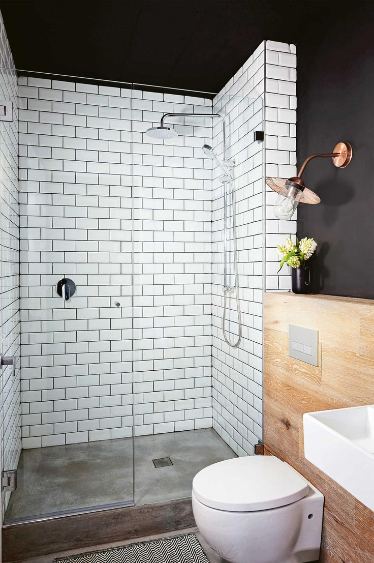 Wow. So bold with the mix of materials, black walls, white tiles, concrete floor, timber wall and copper lighting.
