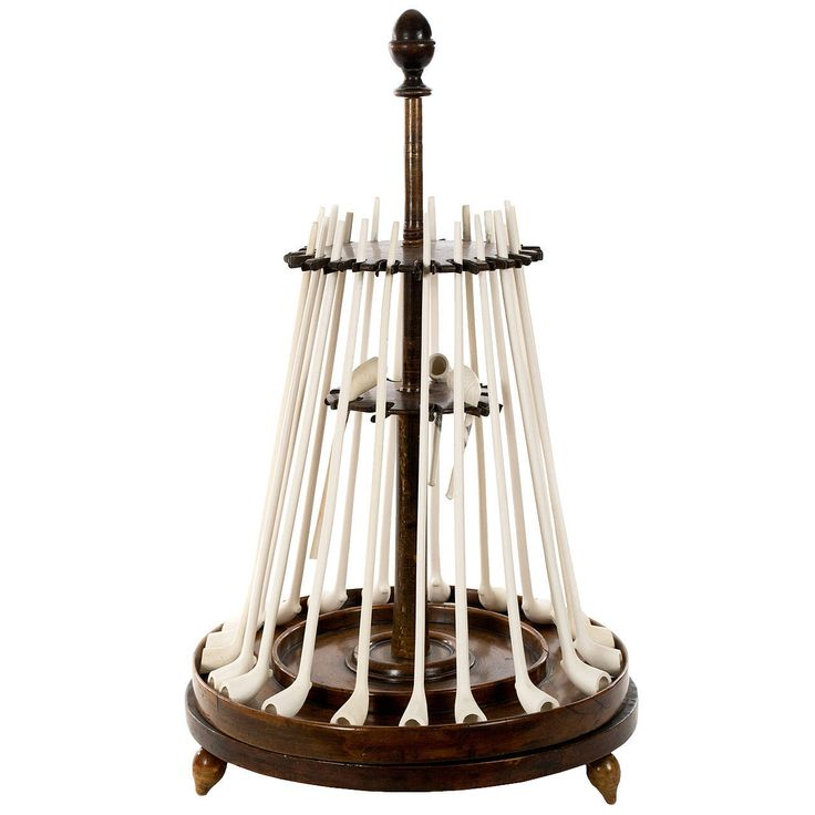 Dutch Pipe Stand in Carved Walnut -- Turned in beautiful walnut, this pipe stand was made in Holland during the third quarter of the nineteenth century, and can hold several traditional clay or standard-sized pipes.