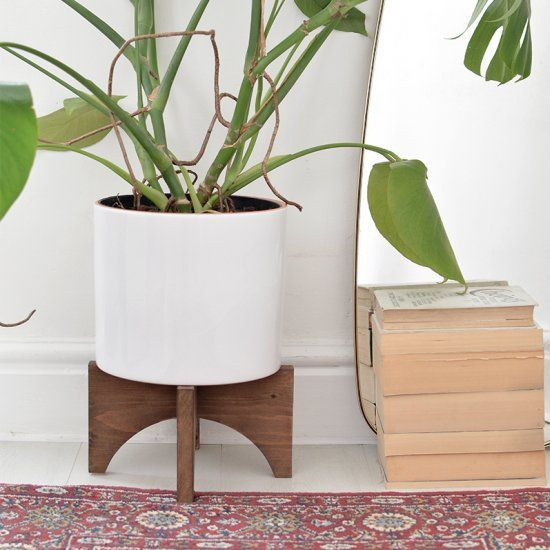 learn how to make a mid century inspired plant stand!