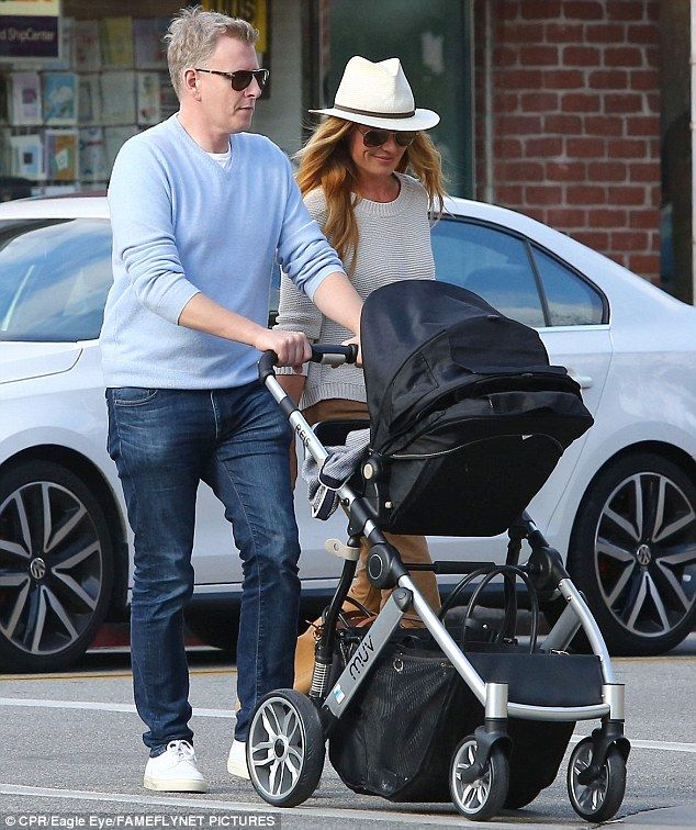 Three is the magic number:Cat Deeley and Patrick Kielty looked utterly smitten as they took their bundle of joy out on a low-key stroll around Beverly Hills on Thursday afternoon
