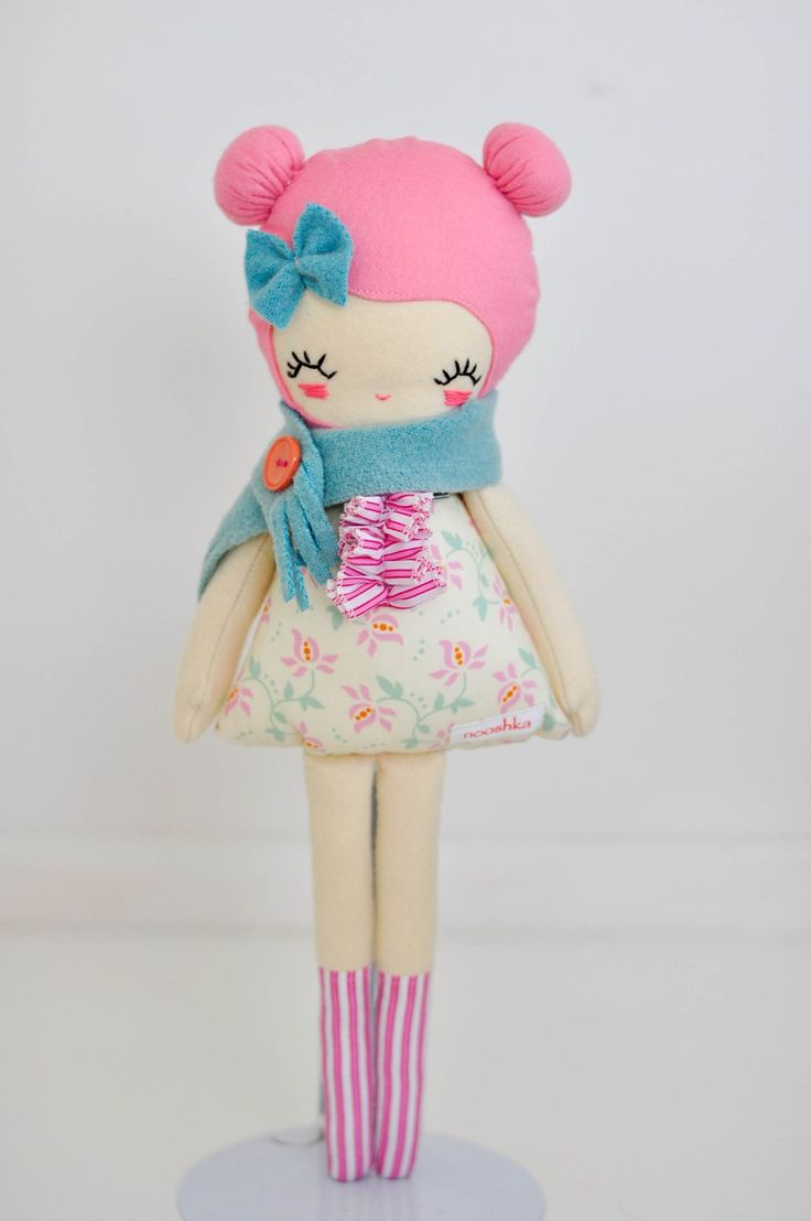 pink and blue fabric doll