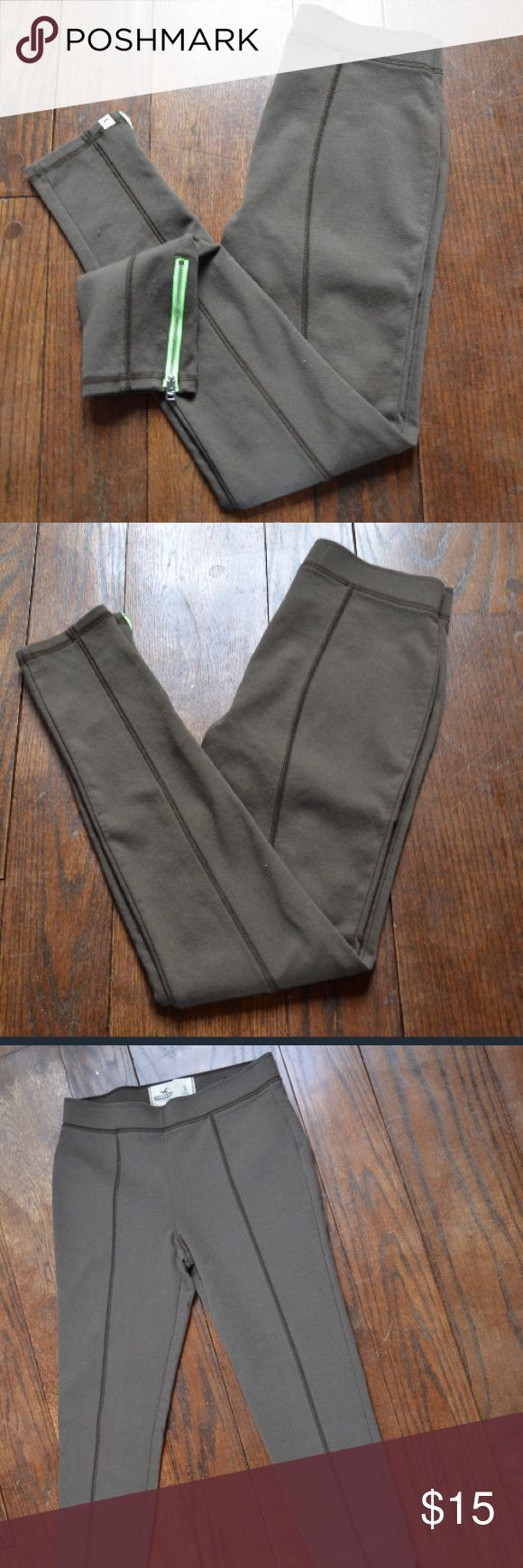 Hollister Leggings Hollister green workout leggings with neon green side zippers on the bottom of each leg. 65% cotton, 30% polyester, and 5% elastane. Be comfortable and look great at the same time!  Size: Small Brand: Hollister Hollister Pants Leggings