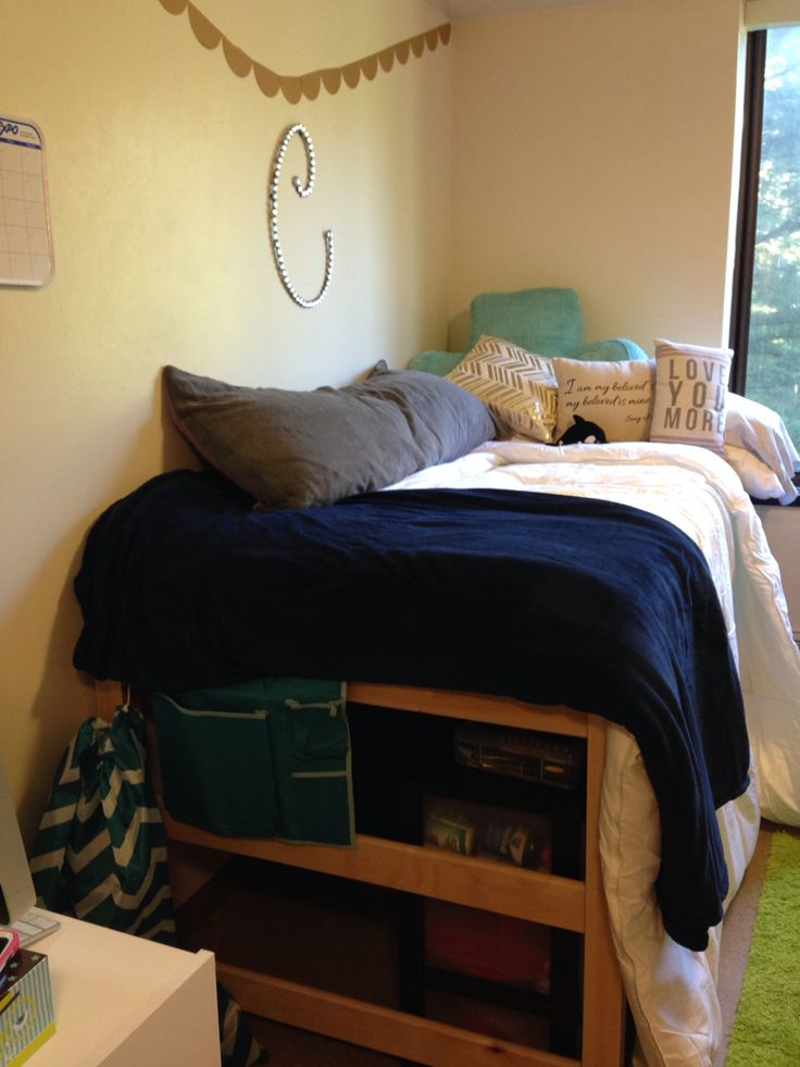 Dorm room: Wow this is sooo me, the initial C, the navy blue and silver, and everything