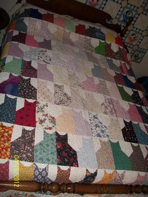 Cats...made this quilt in fall colors a number of years ago and my niece JUST HAD TO HAVE IT!!!!