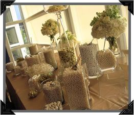 wedding candy bar - I love the idea of different size/shape glass containers bunched on a table with monochromatic color scheme or theme colored candies....