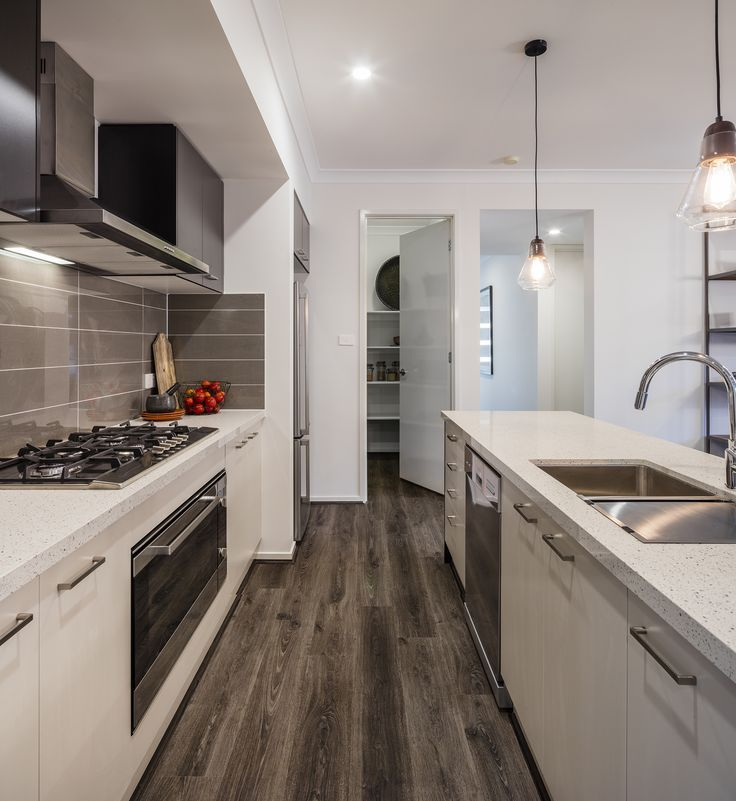 Domaine Homes. Malibu 24. Kitchen with walk in pantry. Internal Colour Scheme: Burnt Forest