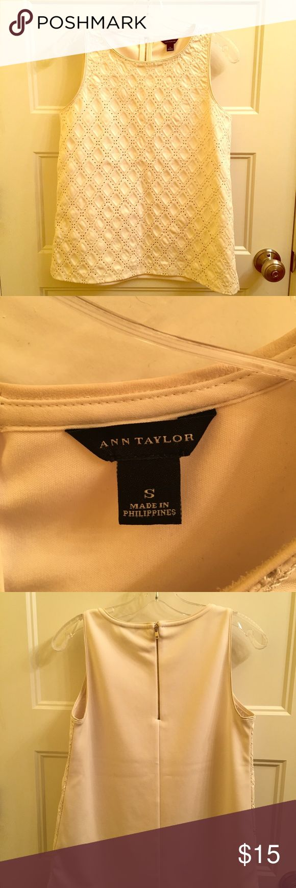 Leather-look sleeveless shell top from Ann Taylor This beauty falls somewhere between wardrobe staple and statement piece! Leather-look shell in versatile off white, looks just as classy as you'd expect from Ann Taylor. The back features a zipper accent. Great quality top! Ann Taylor Tops