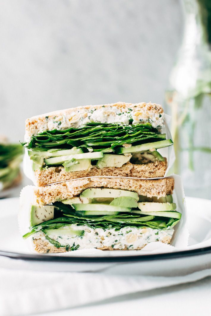Smashed Chickpea Green Goddess Sandwich - herbed goat cheese and smashed chickpeas loaded between two slices of bread with all your favorite green veggies. This is the perfect lunch! #greengoddesssandwich #sandwich #smashedchickpea #chickpeas   Littlespicejar.com