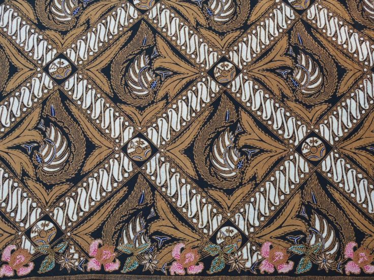 A tribute to Iwan Tirta the BATIK Maestro on Batik day 2012.The back part of the Batik, combination  of geometric sqares and on the edges are flowers
