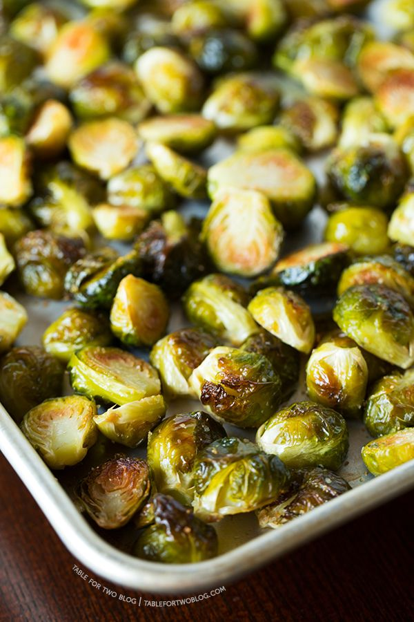 One of the best ways to eat brussel sprouts is to roast them with some garlic! Recipe on tablefortwoblog.com