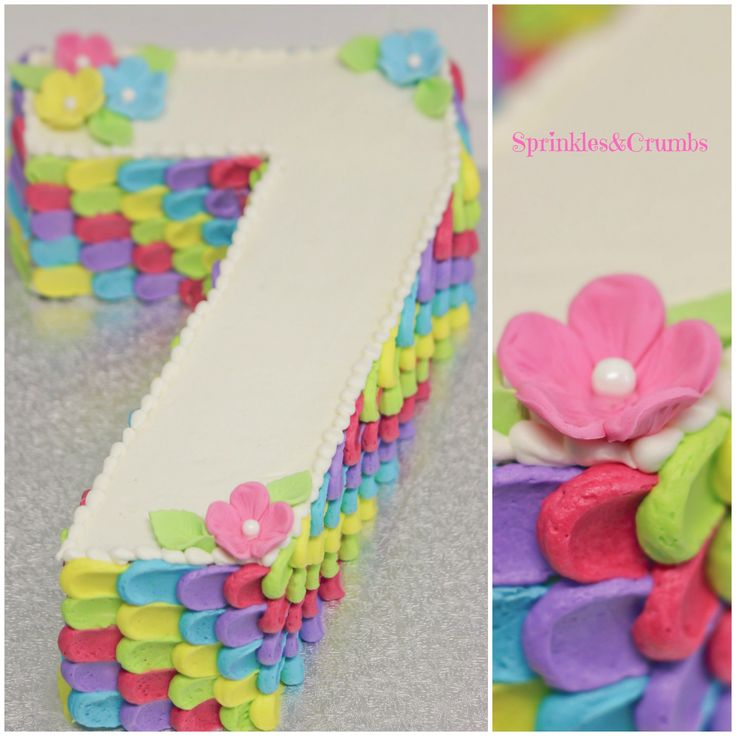 Rainbow petals, number 7 novelty cake for girl.