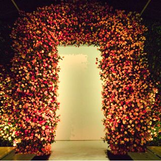 The arch for the Marc Jacobs' runway show was created using thousands flowers and designed by Raul Avila. The white backdrop folded open to ... Photo by Tom Kletecka
