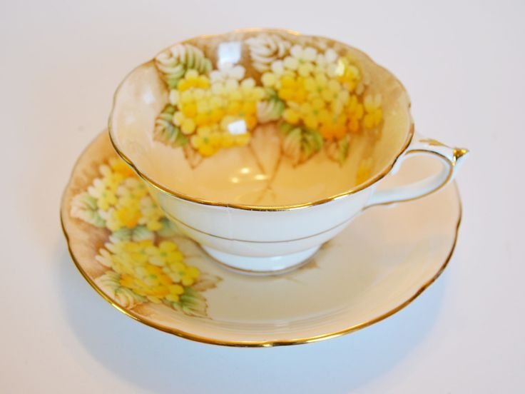 Paragon Yellow and Gold Gilt Bone China Floral Teacup and Saucer - Double Warrant - Hand numbered circa 1930s by Trashtiques on Etsy https://www.etsy.com/ca/listing/563466027/paragon-yellow-and-gold-gilt-bone-china