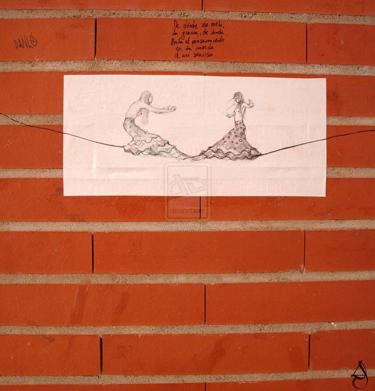 Lola Fernández Corral  De dónde ese vuelo, la gracia, de dónde. Baila el pensamiento en la cuerda de mi sonrisa.  Paper on a wall