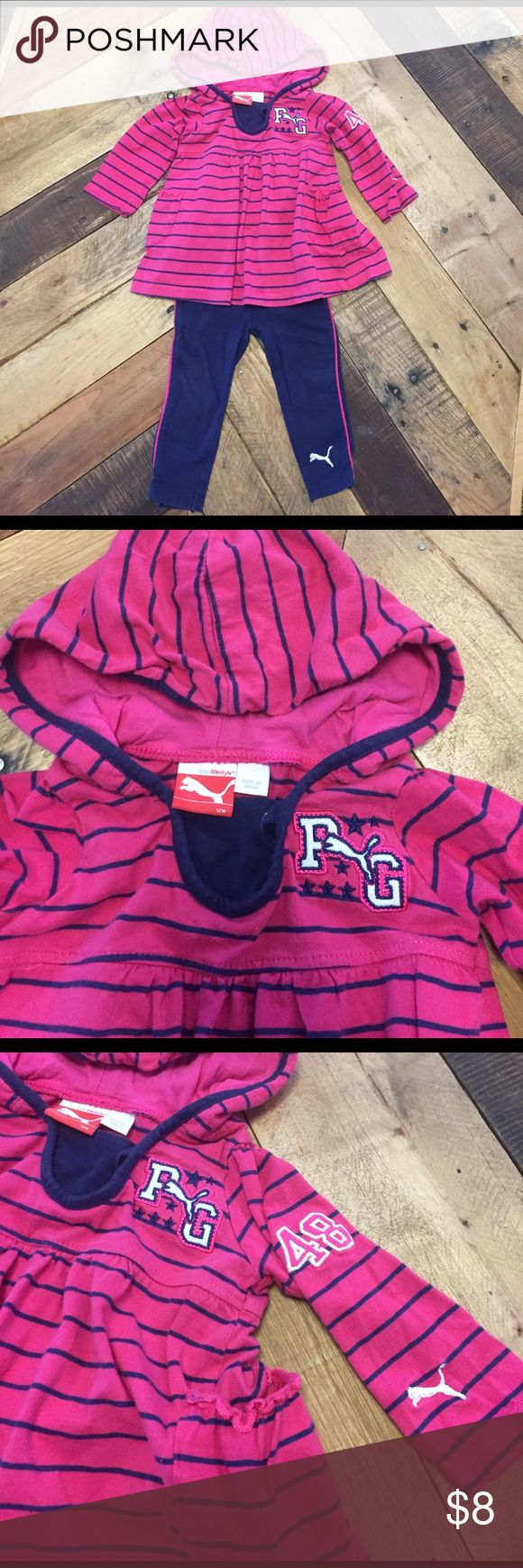 Puma Sport Lifestyle matching set (12 mo) Puma Sport Lifestyle matching baby girl set. pink and Navy. Top is hooded with pockets on the front and Puma logos. Pants have elastic waist and stripe down the side. Adorable outfit, great condition. Puma Matching Sets
