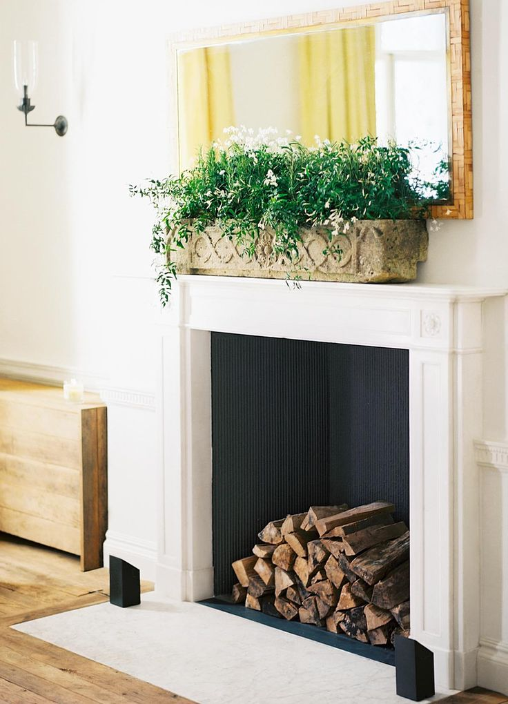 Spring-ify your mantle with a rustic outdoor planter filled with seedlings.