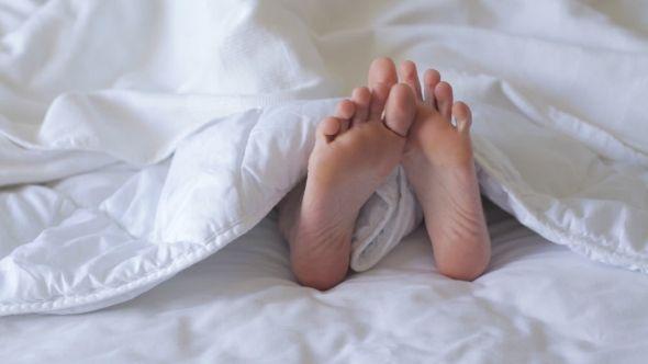 Female Feet in Bed