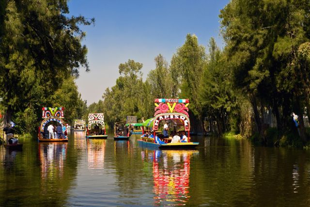 "Visit Mexico City's Floating Gardens in Xochimilco: Canals of XochimilcoXochimilco is a UNESCO World Heritage Site located about 17 miles (28 km) south of the historical center of Mexico City. The name Xochimilco comes from Nahuatl (the language of the Aztecs) and means ""flower garden."""